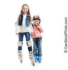 two smiling little girls on rollerskates