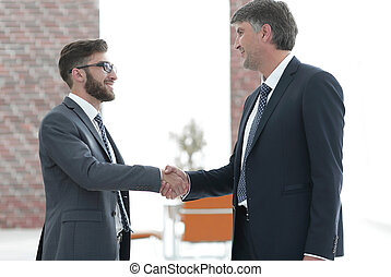 businessmen shaking hands on business meeting in office