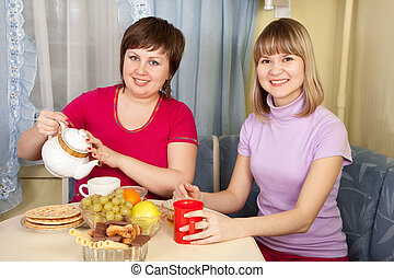 smiling women having tea