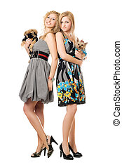 Two smiling young women with dogs