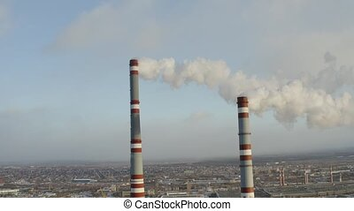 Two smoking pipe in industrial zone, aerial video