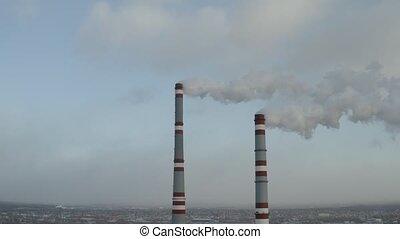 Two smoking pipe in industrial zone, d-log aerial video
