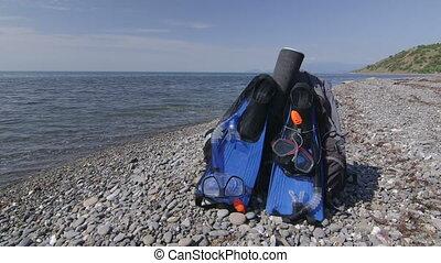 Two snorkeling sets on wild pebble beach in Crimea