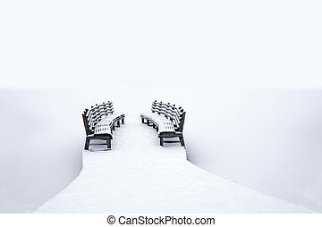 benches on jetty in winter