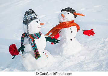 Two Snowmen - A lovely couple - Couple of snowmen looking at...