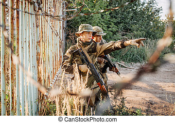 Two soldiers are exploring an unfamiliar area - Two rangers ...