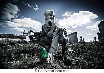 Two soldiers in the gas masks and protective clothes are testing biological weapon on the ruined background.