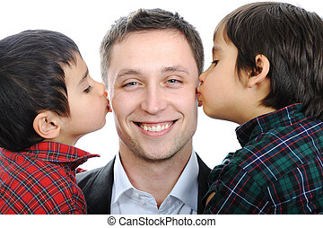Two sons kissing father
