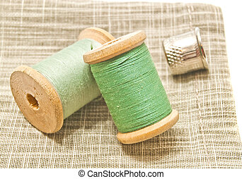 two spools of green thread