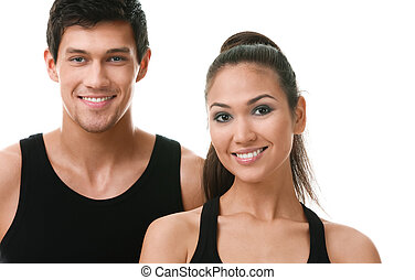 Two sportive people in black sportswear