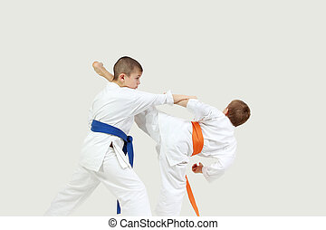 Two sportsmen are doing blows