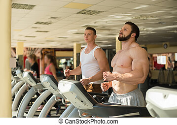 Two sportsmen in gym.