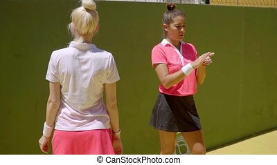 Two sporty young tennis players warming up