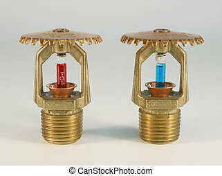 two sprinkler heads - Two sprinkler heads over a white...