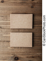 Two stack of blank craft business cards on wooden background Vertical