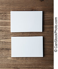 Two stack of blank white business cards on wooden background Vertical