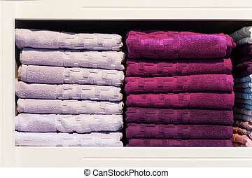 Two stacks of towels on a shelf in the store