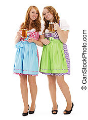 two standing bavarian woman with beer on white background