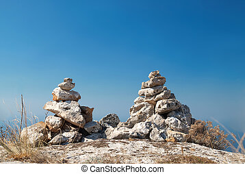 Two stone towers - stacks of zen stones on a blue sky...