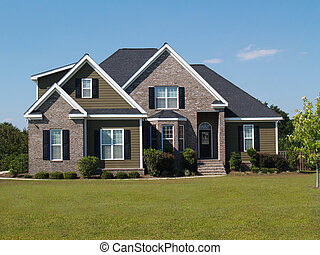 Two story brick and vinyl home.