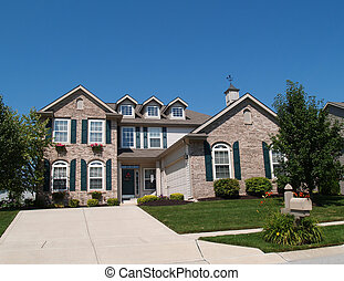 Two Story Brick Home with Window Bo
