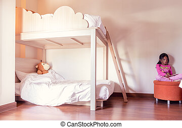 Two-story children's beds in the bedroom, A girl sitting on a stool