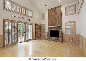 Two story family room with brick fireplace