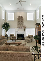Two story living room with marble fireplace