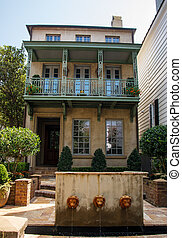 Two Story Plaster Home Behind Lion Fountain