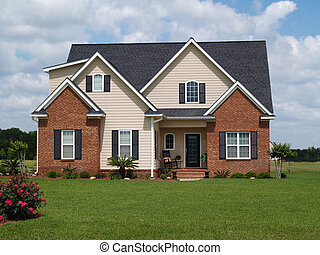 Two story residential home with both brick and board siding on the facade.