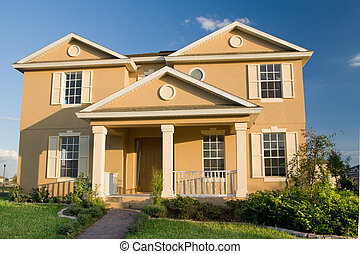Two-Story Stucco Home - two-story stucco home with...