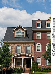 Two Story Townhouses - Two story brick townhouses under a...