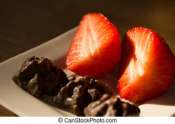 two strawberries or three pieces of chocolate
