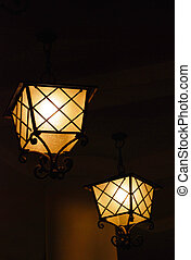 black night. Two streetlight flash on the street