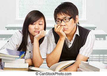 Two stressful students - Two stressfull students looking...
