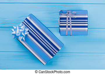 Two striped blue gift boxes.