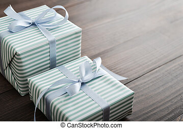 Two striped gift box with blue ribbon