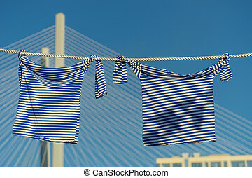 two striped vests on blurred background of Golden bridge and sky.