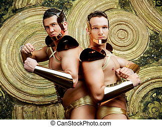 dancers wearing costumes with golden armour