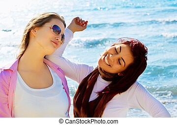 two student girls at the sea.