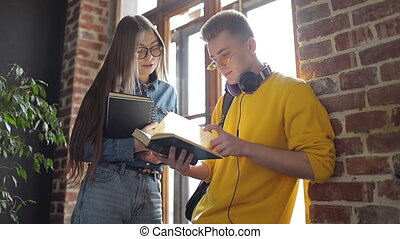 Two Students having Discussion on Notes - Two students...