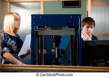 Two students in front of a monitor in practice