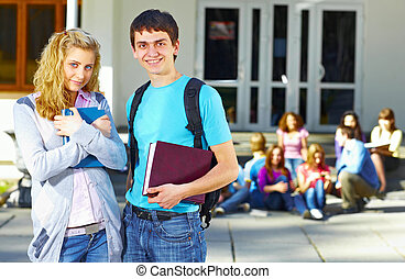 Two students in front of group