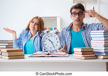 Two students runnng out of time to prepare for exams