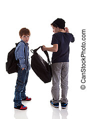 two students seen with his back to the school bags, one looking back