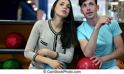 Two students talk and then saw something at bowling club