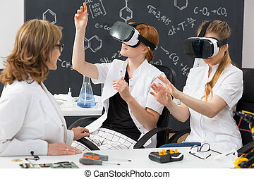 Two students wearing VR goggles