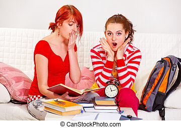 Two studying girlfriends shocked because running out of time