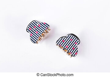 Two stylish hair clips on white background.