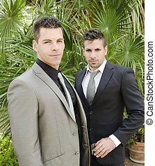 Two suit young men posing looking at the view